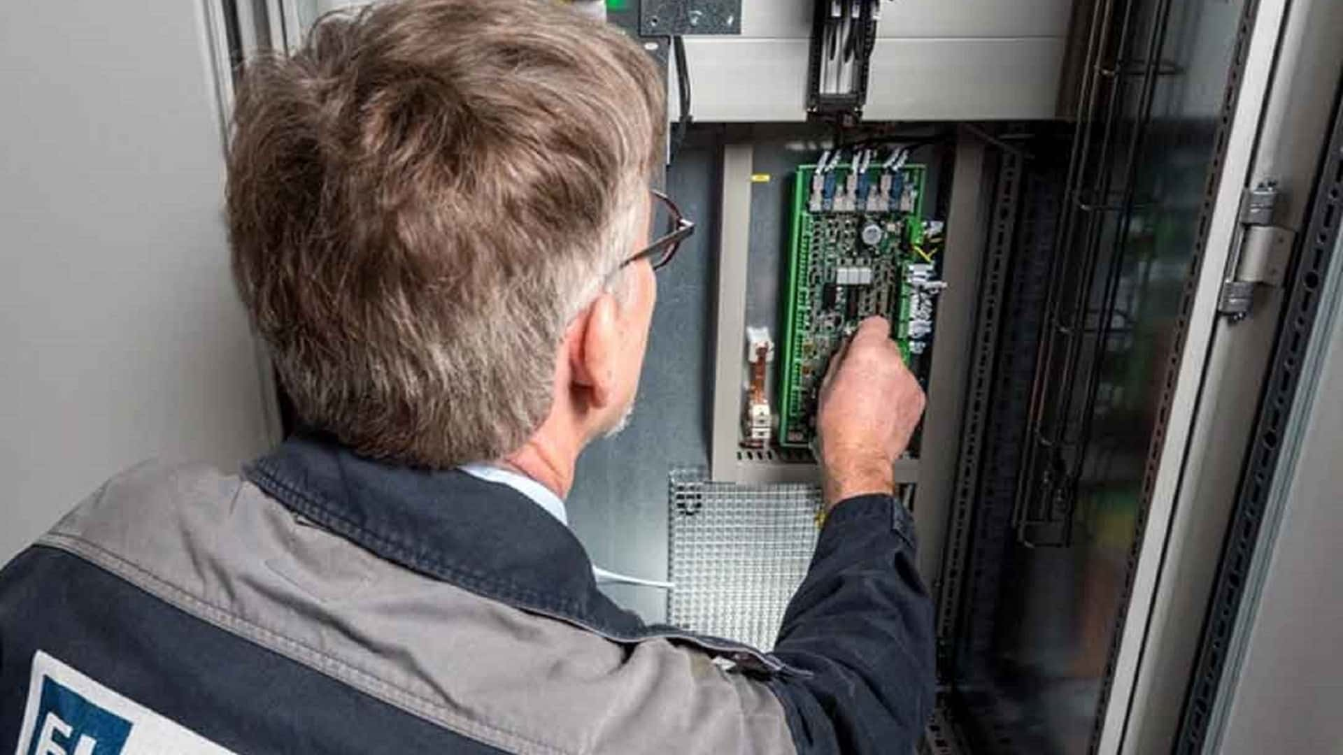 Engineer working on electrical panel