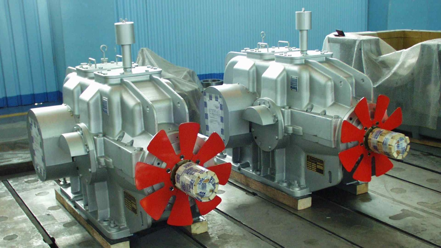 Two MAAG® KA gear units with red fan installed on the input shaft